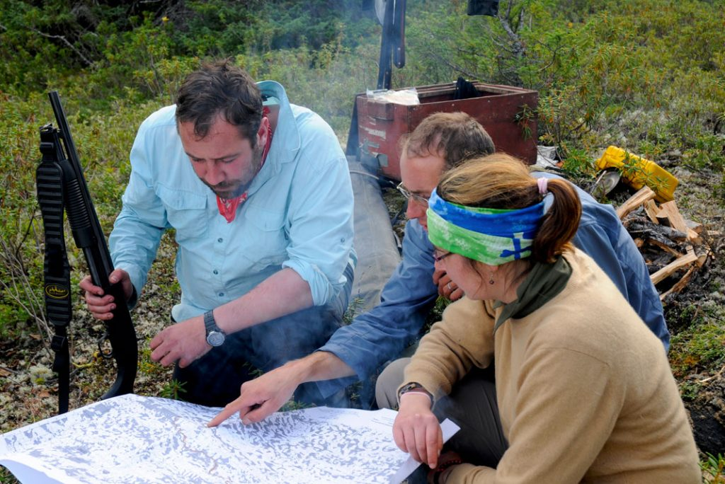 A group makes a safety plan in polar bear country.