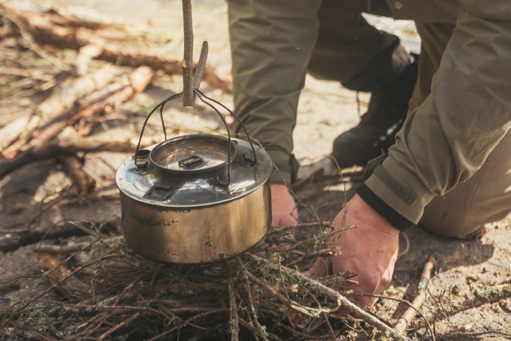 Cooking over a backcountry campfire