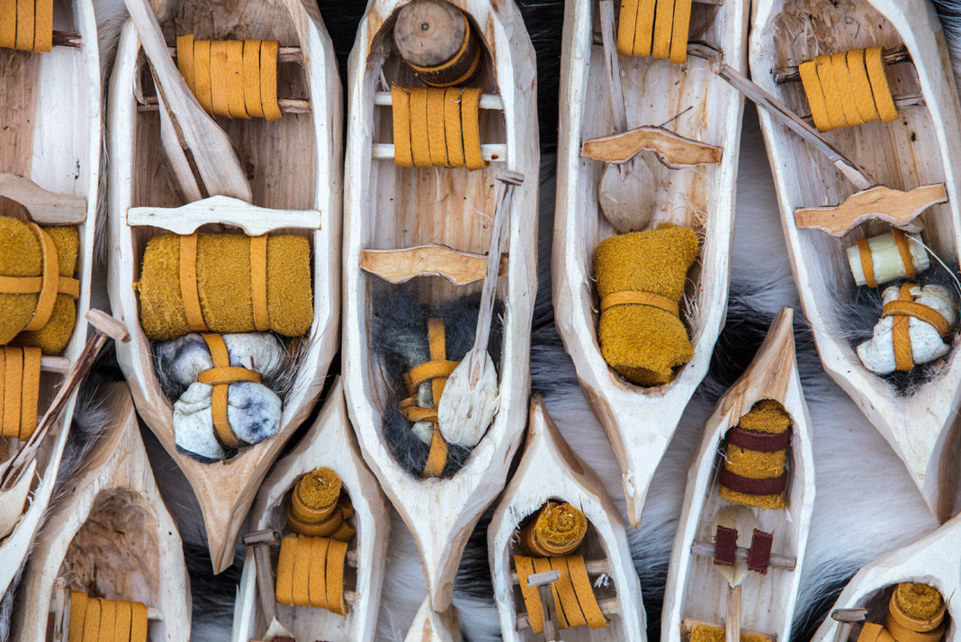 Mike Ranta adds tiny paddles, thwarts, seats, and voyageur sacks out of fur and hide