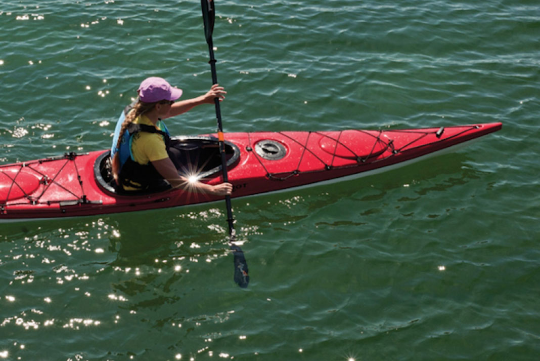 Person paddling in the Riot Edge 14.5 kayak