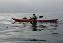 Man paddles in the Valley Nordkapp RM sea kayak