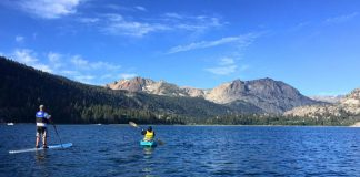 Kayaking on the water with mountains in the background