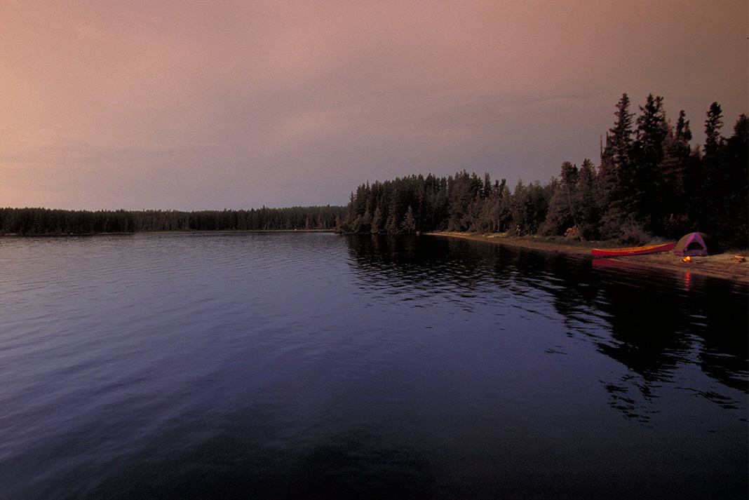 Camping on the shore of a dark lake
