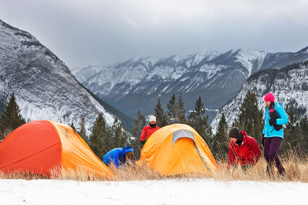 Campers setting up tents on the snowcapped mountains in Banff