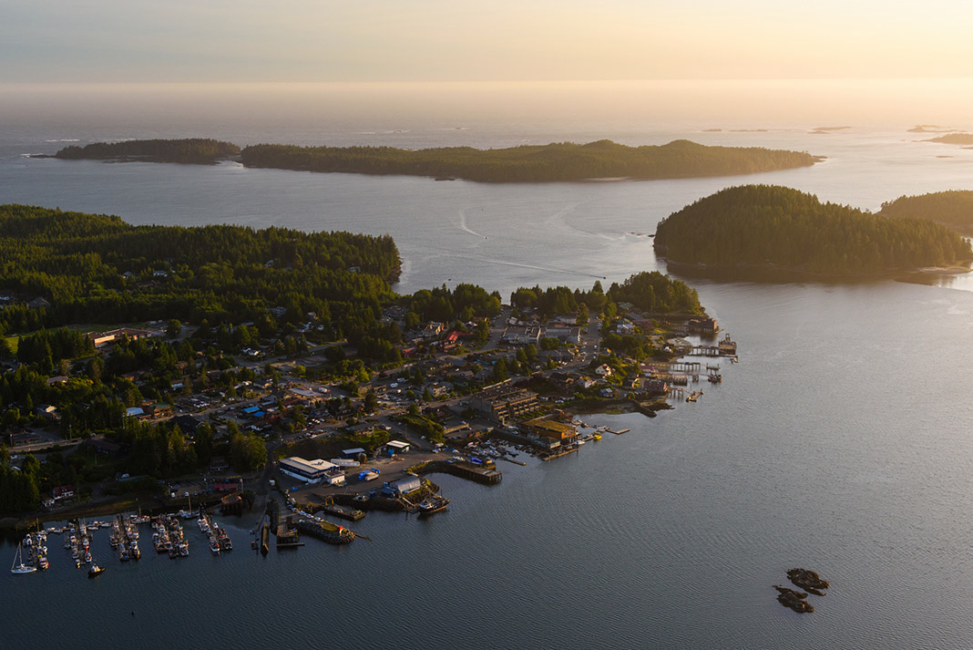 An overview shot of Tofino and numerous watercraft on the ocean waters