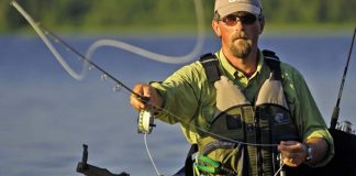 Kayak angler fly fishing from kayak
