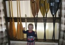 Mike Zilkowski's child helps build a paddle rack