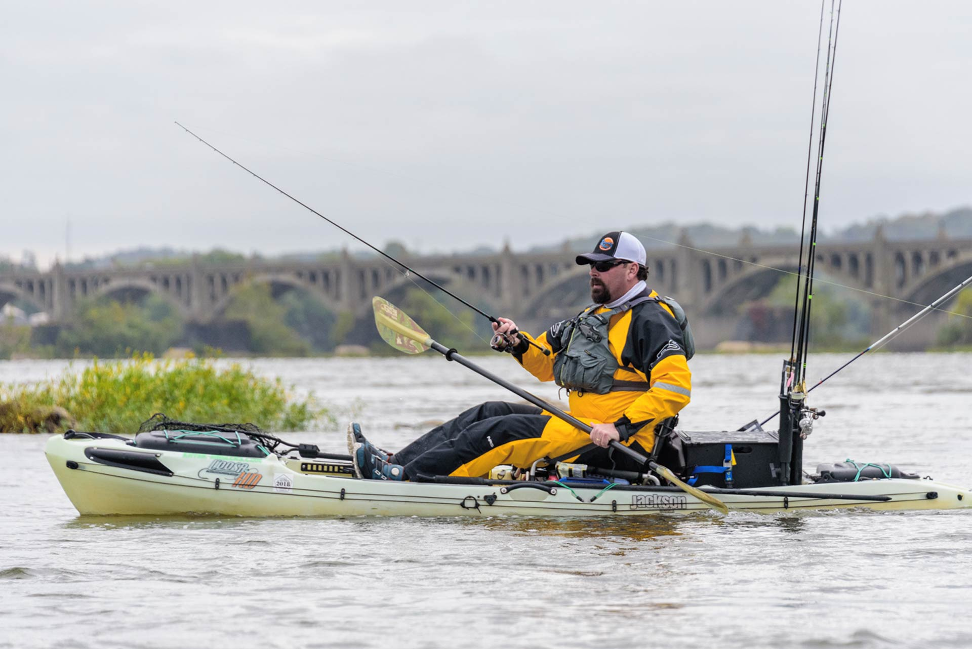 Angler fishing in a drysuit in his kayak
