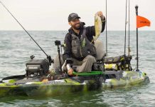 kayak angler holds bass on lake st. clair michigan