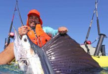 Kayak angler holds up a large swordfish.