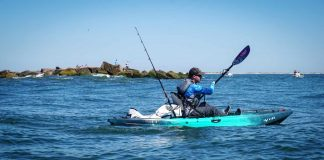 Kayak Angler paddles a large lake